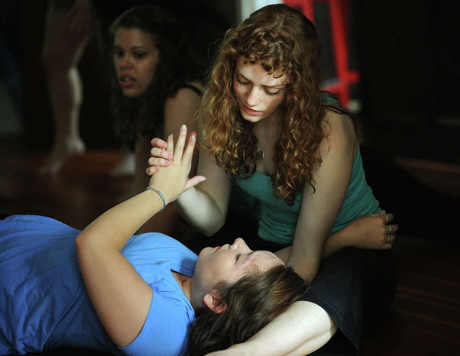 Student actors Olivia Gregorich, top, of Greenwood, Wisconsin, and Patty Hamilton, of Seattle, Washington, participate in Viewpoints, an interactive exercise, at Shakespeare Academy @ Stratford, CT, a new theater education program on the grounds of the American Shakespeare Festival Theatre in Stratford, Conn. on Thursday, July 3, 2014. The students will be performing two of Shakespeare's plays, Hamlet and Cymbeline, from August 2 through August 10. Photo: Brian A. Pounds / Connecticut Post
