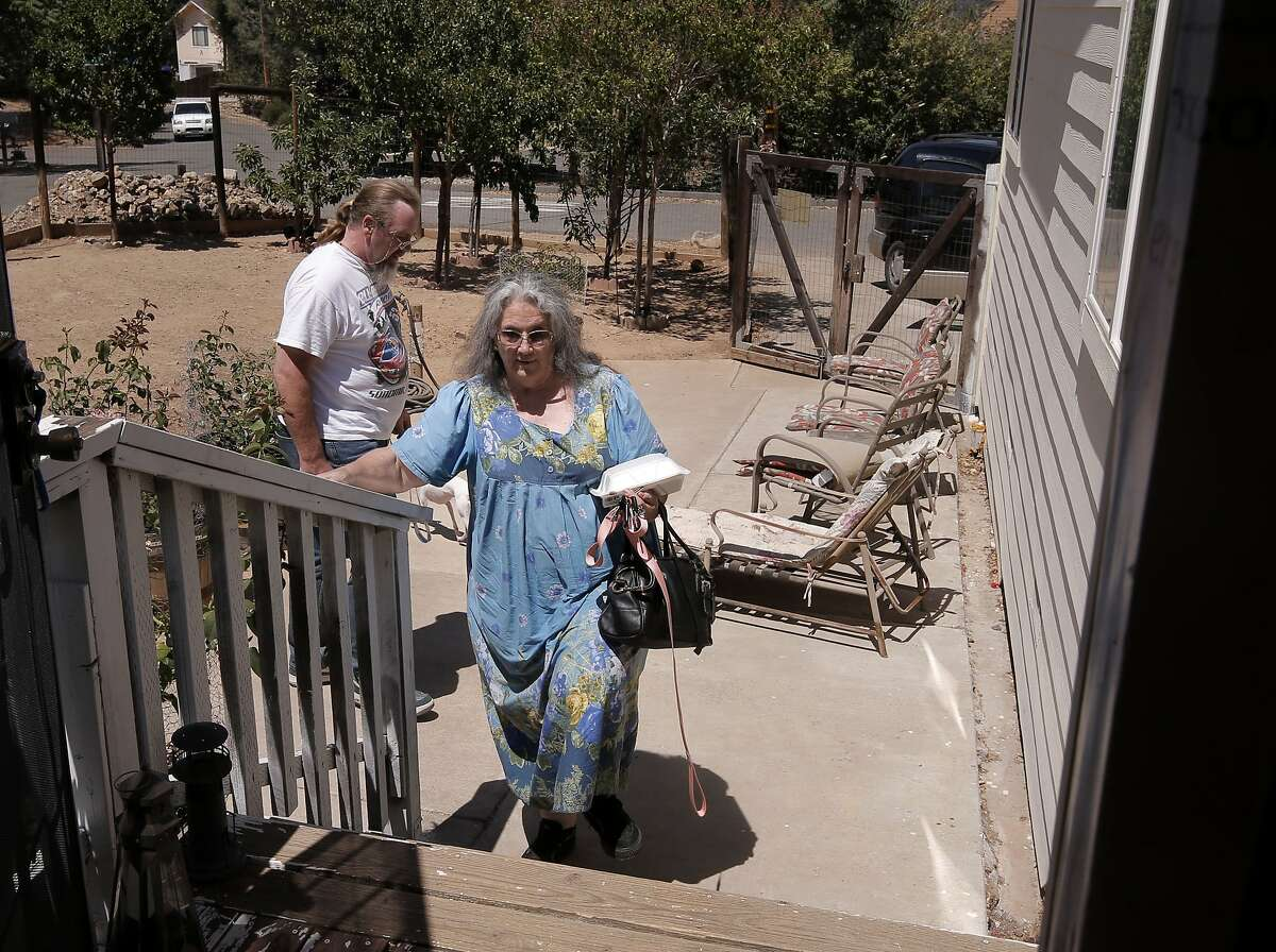 Ricky and Dorothy Hurst, (son and mother) return home after the mandatory evacuation in the Berryessa Estates neighborhood was lifted as firefighters continue the battle against the Butts Fire on Thursday July 3, 2014, in Pope Valley, Calif.