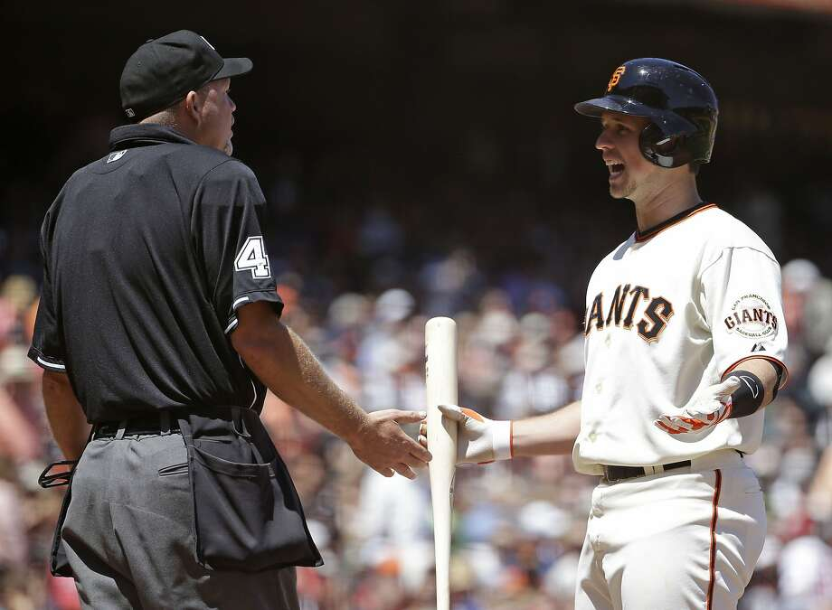 Buster Posey tries to convince umpire Ron Kulpa that he hadn't struck out in the fifth. Photo: Eric Risberg, Associated Press