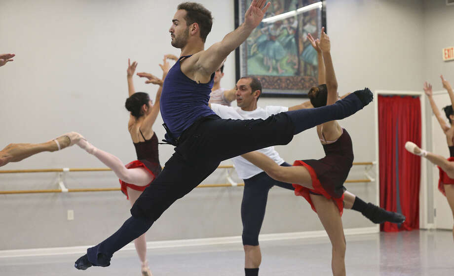 "Paolo Cervellera, who will perform in the duet ""Spring Waters,"" flies across the room as Ballet Latino de San Antonio rehearses for its show next weekend. Photo: Photos By Tom Reel / San Antonio Express-News"