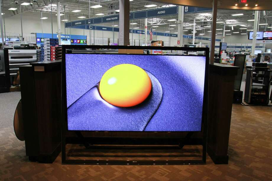 On display at the Magnolia Design Center in the Best Buy on Richmond is an 85-inch Samsung 4K Ultra HD TV. Consumers have gained large-screen choices this year. Photo: Gary Fountain, Freelance / Copyright 2014 by Gary Fountain