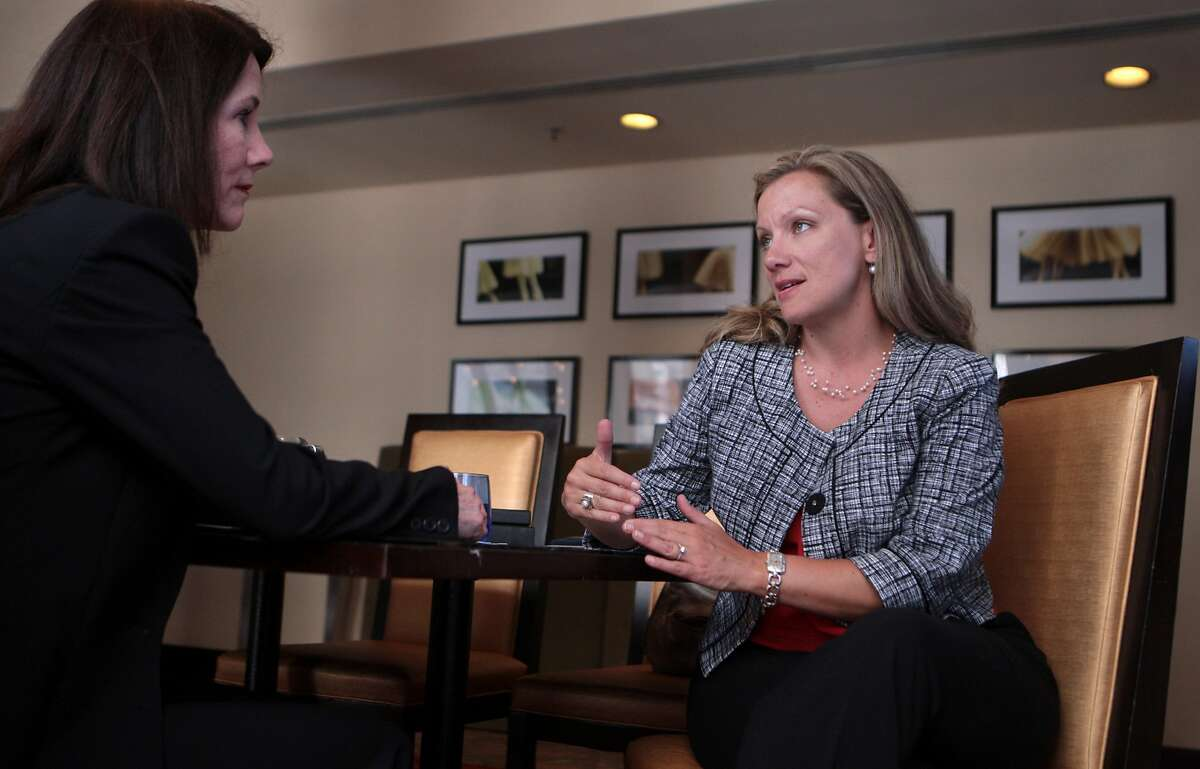 Kathleen Thurmond, left, meets with mortgage consultant Brittany Keyes in a meeting space rented via LiquidSpace at the JW Marriott Hotel Union Square in San Francisco, Calif. on Monday, June 30, 2014.
