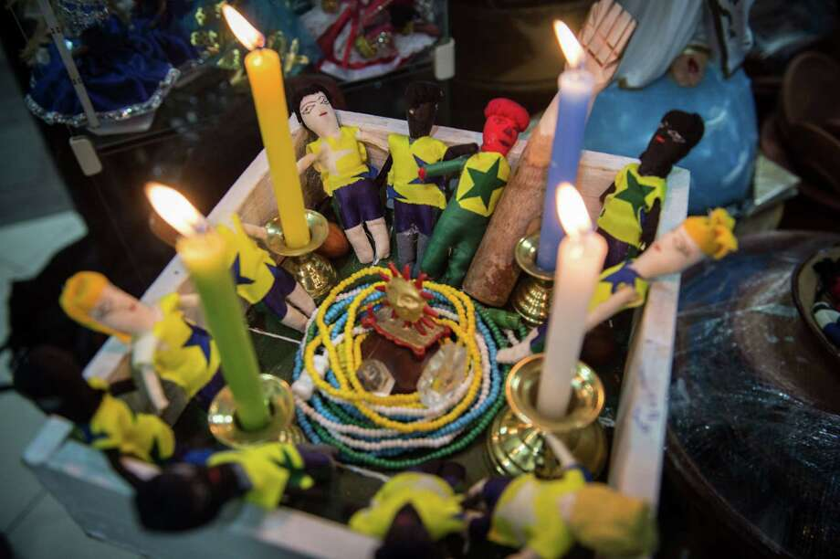Group of small dolls representing Brazil's national football players set inside a special box to enhance power and luck on them as part of the Afro-Brazilian religious ritual, taken at a religious goods shop, in Rio de Janeiro, Brazil, on July 3, 2014. Brazil will face against Colombia on July 4 in a quarter-final of the FIFA World Cup match in Fortaleza. Photo: YASUYOSHI CHIBA, AFP/Getty Images / AFP