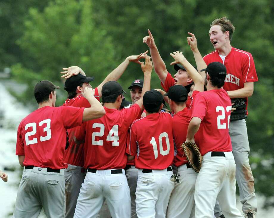 The Redmen celebrate their victory over BANC at the end of the Greenwich Senior Babe Ruth Baseball Championship game between BANC and the Redmen at Havemeyer Field in Greenwich, Thursday, July 3, 2014. The Redmen won the championship, 11-2, over BANC. Photo: Bob Luckey / Greenwich Time