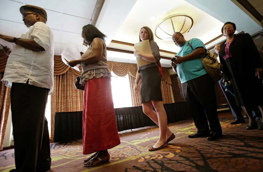 In this Thursday, June 12, 2014 photo, people wait in line for the Cleveland Career Fair in Independence, Ohio. U.S. employers accelerated their hiring in June, adding a robust 288,000 jobs and helping drive the unemployment rate to 6.1 percent, the lowest since September 2008, the Labor Department reported, Thursday, July 3, 2014. (AP Photo/Tony Dejak) ORG XMIT: NYBZ181 Photo: Tony Dejak / AP