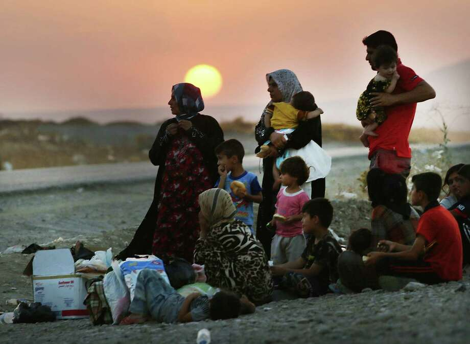 Iraqis who fled fighting near Mosul prepare to sleep on the ground after they tried to enter a displacement camp but were blocked by Kurdish soldiers in Khazair. Photo: Spencer Platt / Getty Images / 2014 Getty Images