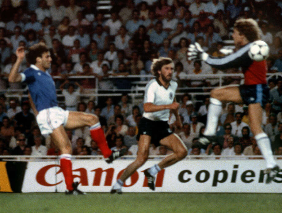 West German keeper Harald Schumacher (right) collided with Patrick Battiston (left) in this 1982 World Cup semifinal, breaking the French defender's jaw and knocking him unconscious. Photo: Getty Images File Photo / AFP