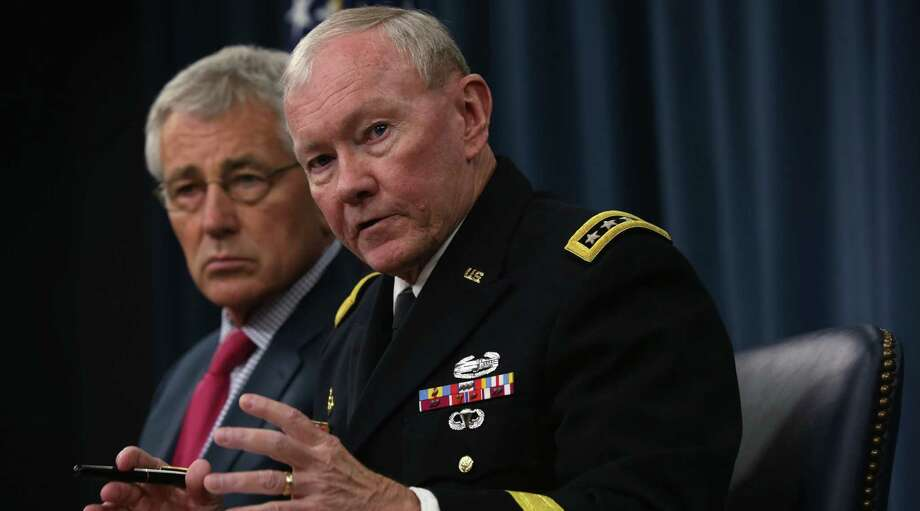 Chairman of the Joint Chiefs Gen. Martin Dempsey (right), joined by Defense Secretary Chuck Hagel, says American troops aren't in combat in Iraq. Photo: Alex Wong / Getty Images / 2014 Getty Images