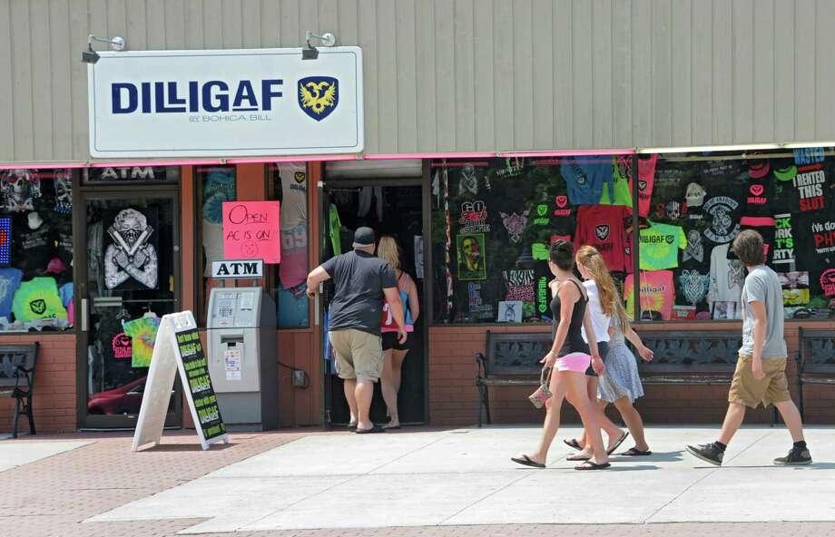 People shop along the main drag on Wednesday, July 2, 2014 in Lake George, N.Y.   (Lori Van Buren / Times Union) Photo: Lori Van Buren / 00027606A
