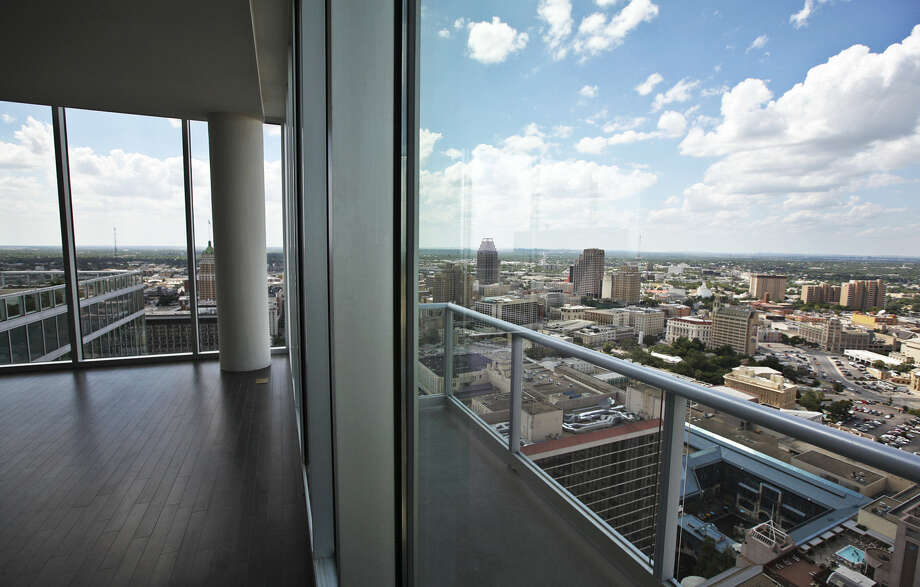 Views of downtown San Antonio such as this from a penthouse at Alteza Luxury Residences attract condo and townhouse sales, which grew 18 percent during the first five months of 2014, the sharpest boost upward of any of the four major Texas markets. Photo: Andrew Buckley / San Antonio Express-News / abuckley@express-news.net