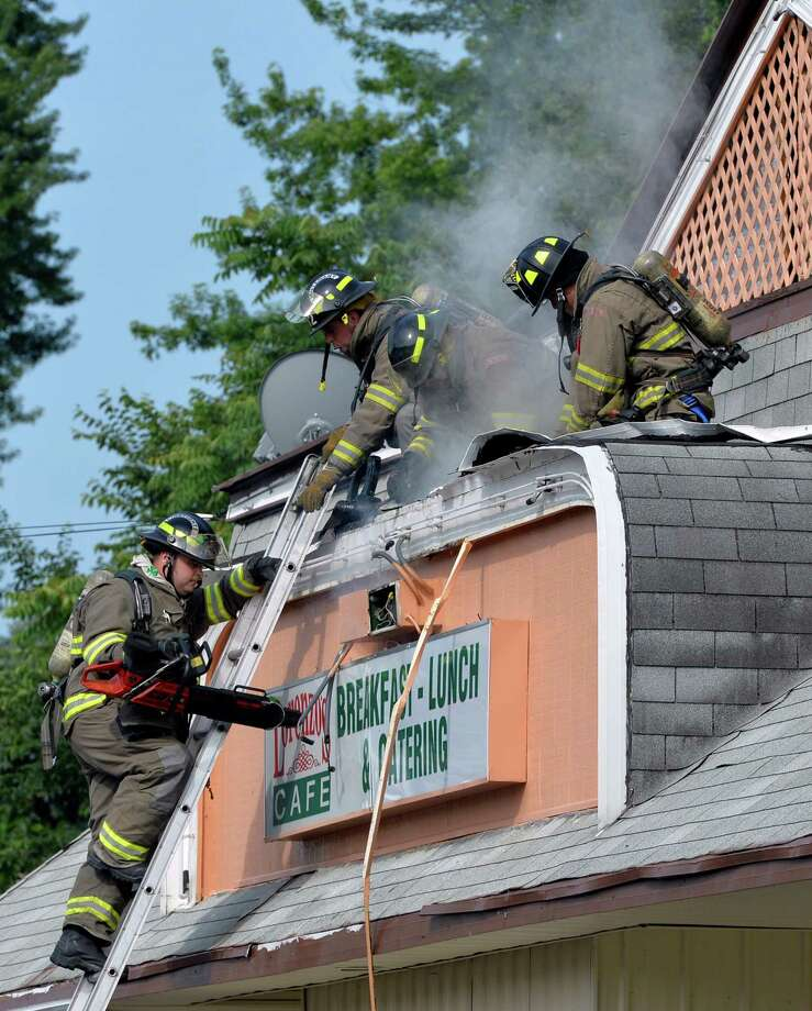 Firefighters control a small fire at Lorenzo's restaurant at 1500 State Street in Schenectady, N.Y.   (Skip Dickstein / Times Union) Photo: SKIP DICKSTEIN