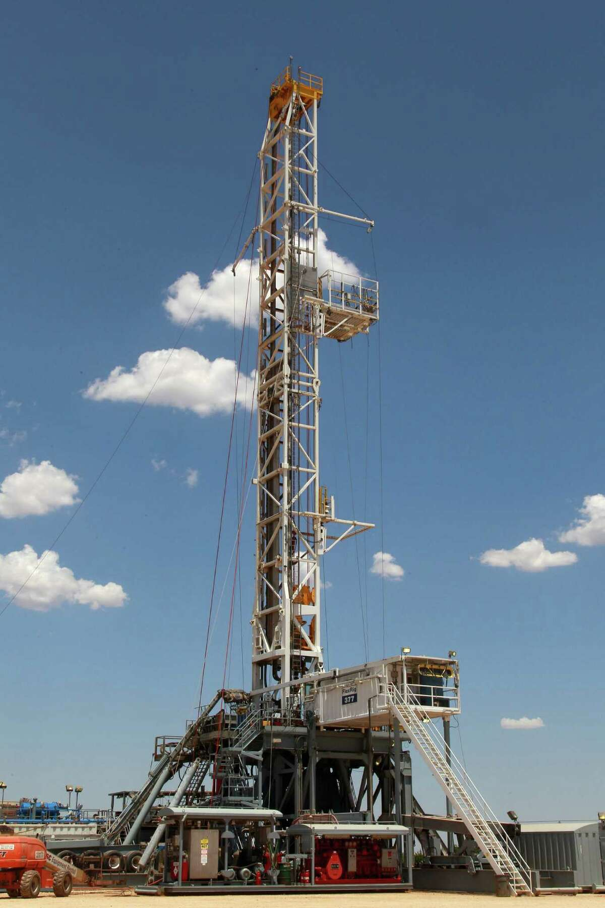 A new study sees a possible link between injection of oil and gas wastewater underground and quakes in Oklahoma. This rig is working near Oklahoma City.