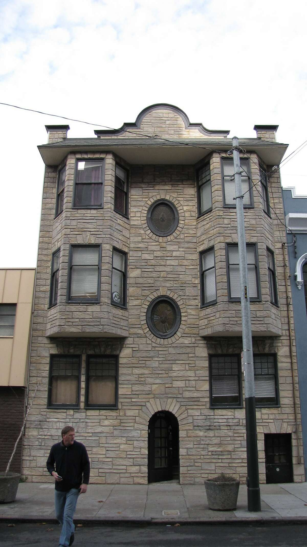 An early 20th Century collection of flats on the 100 block of Page Street, covered in Perma-Stone at some point decades ago.