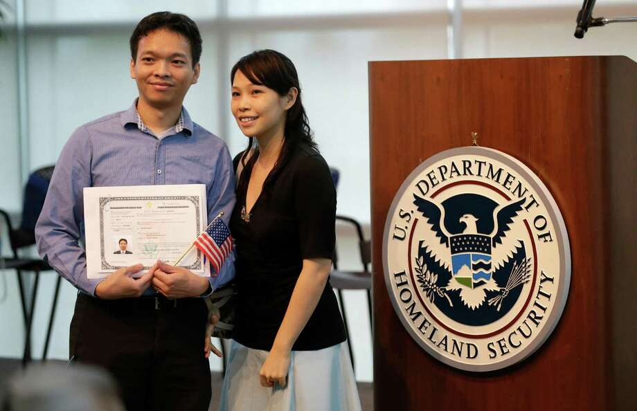 A new U.S. citizen posses for a photo after a naturalization ceremony in Irving, Texas, Thursday, July 3, 2014. Photo: LM Otero, Associated Press / AP