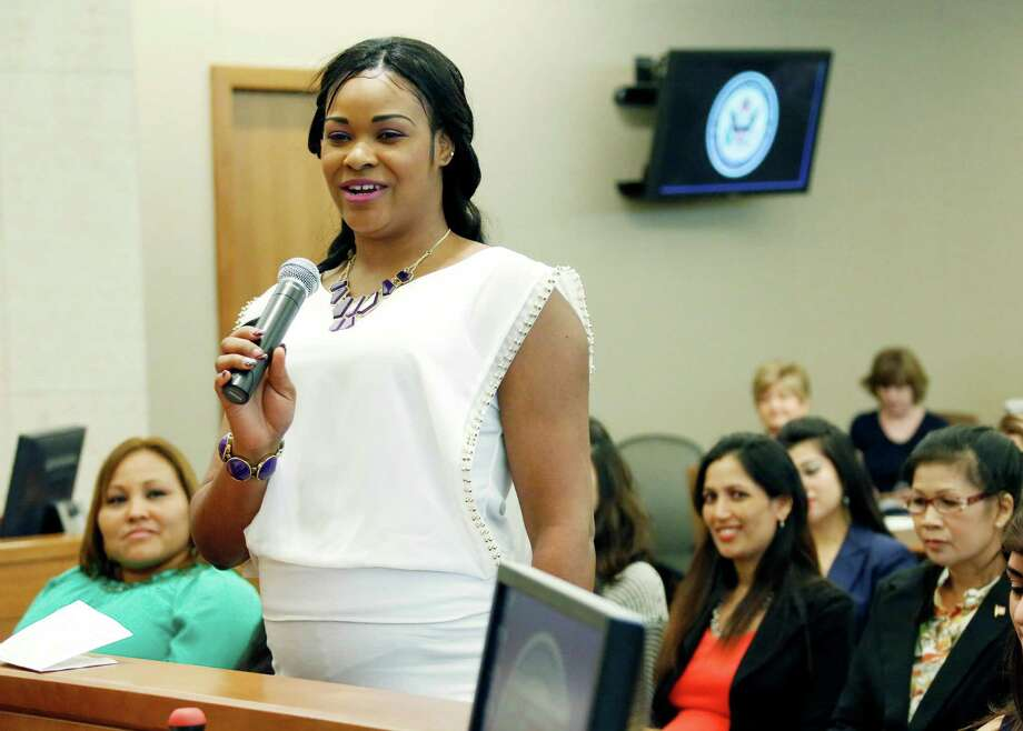 New American citizen, Kemeisha Latoya Morrison, formerly a citizen of Jamacia, stands among other newly sworn in citizens and expresses her feelings about becoming an American citizen, Thursday, July 3, 2014 at the federal courthouse in Jackson, Miss.  Photo: Rogelio V. Solis, Associated Press / AP