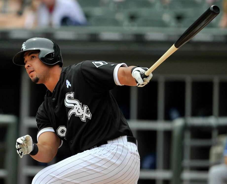 Chicago White Sox's Jose Abreu watches his double during the first inning of a baseball game against the Kansas City Royals in Chicago, Sunday, June 15, 2014. (AP Photo/Paul Beaty)  ORG XMIT: CXS112 Photo: Paul Beaty / FR36811 AP