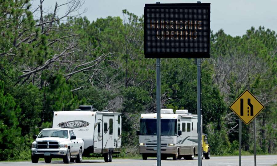 A sign warns travelers as recreational vehicles arrive in Nags Head, N.C., after departing Hatteras