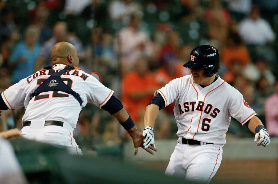 It was fitting that close friend Carlos Corporan, left, was on hand to greet Astros infielder Kiké Hernandez after he hit his first home run on Wednesday. Photo: Karen Warren, Staff / © 2014 Houston Chronicle