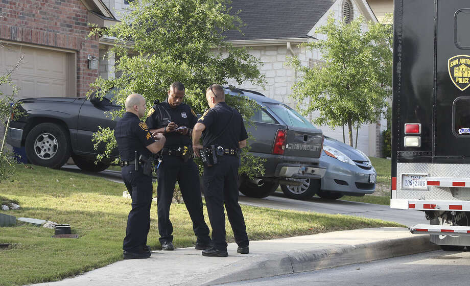 Police document information and evidence at a home in the 12100 block of Arbor Mesa on the Northwest Side, where a family disturbance left a 57-year-old man dead from a gunshot, Sgt. Javier Salazar said. He said a 27-year-old man at the home told police he was responsible. Photo: JOHN DAVENPORT, San Antonio Express-News / ©San Antonio Express-News/John Davenport