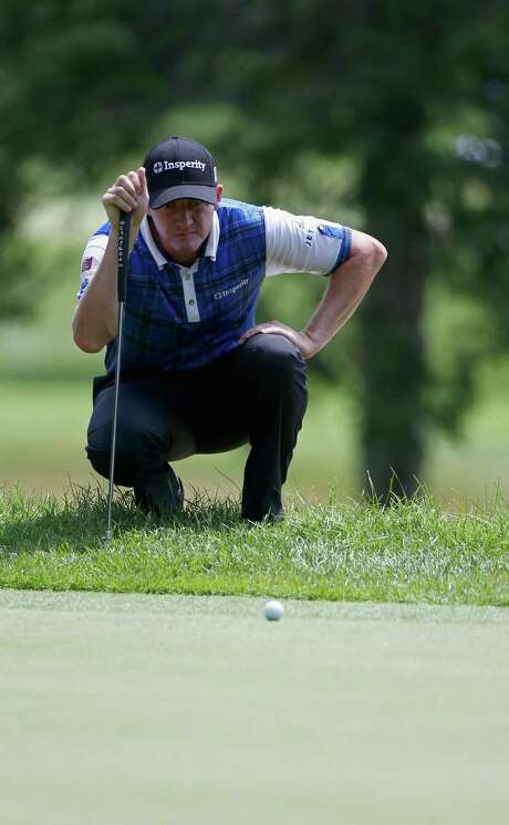 Boerne's Jimmy Walker, who finished with a 70 after the first round, measures a putt on No. 6. He's six shots back of leader Jonas Blixt. Photo: Todd Warshaw, Getty Images / 2014 Getty Images