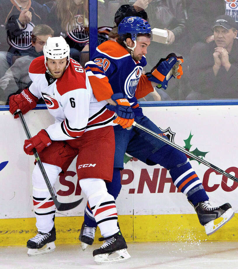 FILE - In this Dec. 10, 2013, file photo, Carolina Hurricanes' Tim Gleason (6) checks Edmonton Oilers' Luke Gazdic (20) during an NHL hockey game in Edmonton, Alberta. The Toronto Maple Leafs have acquired Gleason from the Hurricanes in exchange for John-Michael Liles and a prospect. (AP Photo/The Canadian Press, Jason Franson) ORG XMIT: CPT107 Photo: JASON FRANSON / The Canadian Press