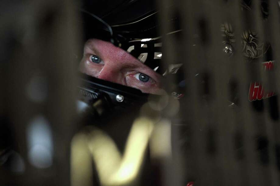DAYTONA BEACH, FL - JULY 03:  Dale Earnhardt Jr., driver of the #88 National Guard Chevrolet, sits in his car during practice for the NASCAR Sprint Cup Series Coke Zero 400 at Daytona International Speedway on July 3, 2014 in Daytona Beach, Florida.  (Photo by Patrick Smith/Getty Images) ORG XMIT: 500372263 Photo: Patrick Smith / 2014 Getty Images