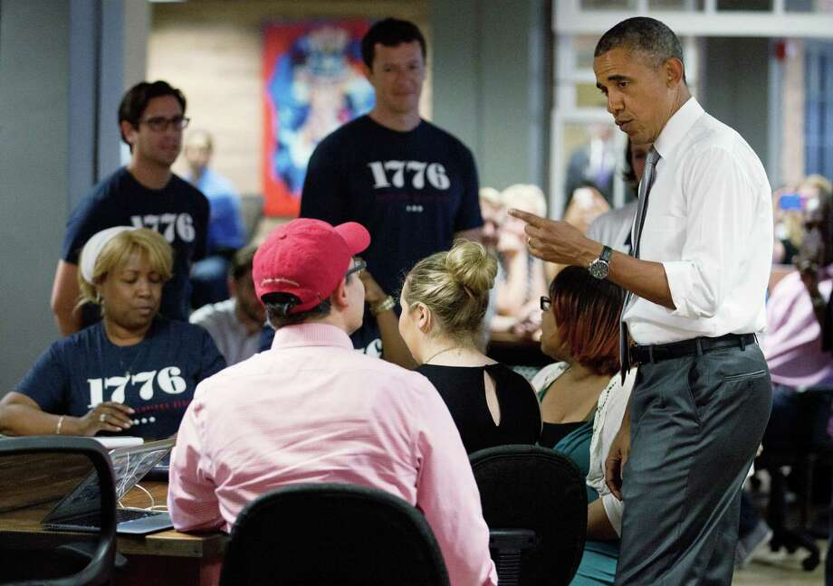 President Barack Obama discusses the economy while talking with workers at the technology startup hub 1776 in Washington. Photo: Martin H. Simon / Getty Images / 2013 Getty Images
