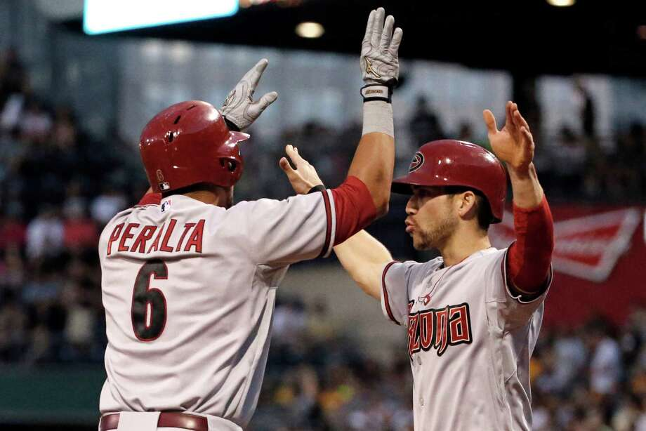 The Diamondbacks' David Peralta (6) celebrates with teammate Ender Inciarte, who was on base for his two-run homer off Pirates starting pitcher Vance Worley during the sixth inning of Thursday night's game. Photo: Gene J. Puskar, STF / AP