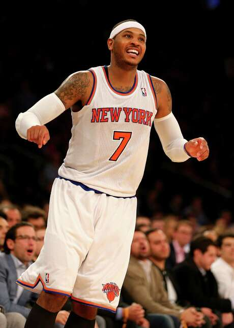 Once Carmelo Anthony decides his fate, other free agents to fall in line. Photo: Elsa, Staff / 2013 Getty Images