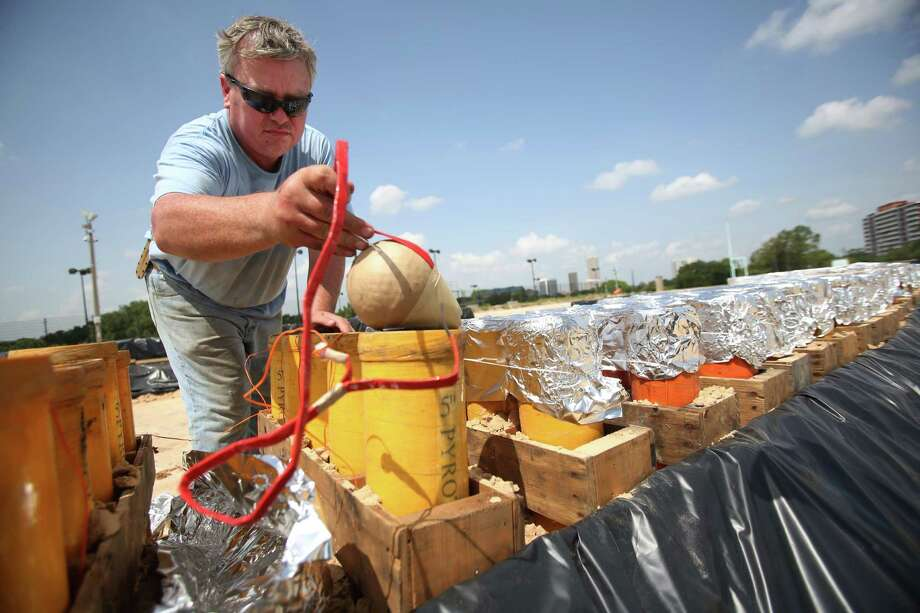 Pyro technician Chris Hanson place fireworks in it's shell in preparation for the 2014 Southwest Airlines Freedom Over Texas festival on July 3, 2014, in Houston, Tx. Photo: Mayra Beltran, Houston Chronicle / © 2014 Houston Chronicle