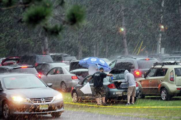 Phish fans scurry into a safe place during a fast-moving storm on Thursday July 3, 2014, at Saratoga Performing Arts Center in Saratoga Springs, N.Y. (Cindy Schultz / Times Union) Photo: Cindy Schultz