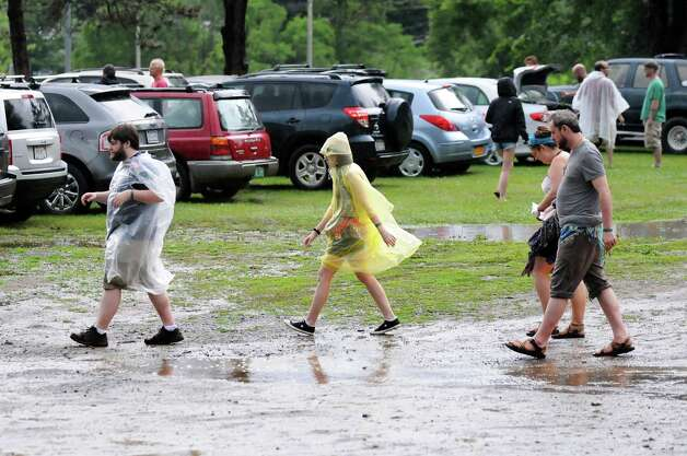 Phish fans navigate the puddles after a fast-moving storm moved through the area on Thursday July 3, 2014, at Saratoga Performing Arts Center in Saratoga Springs, N.Y. (Cindy Schultz / Times Union) Photo: Cindy Schultz