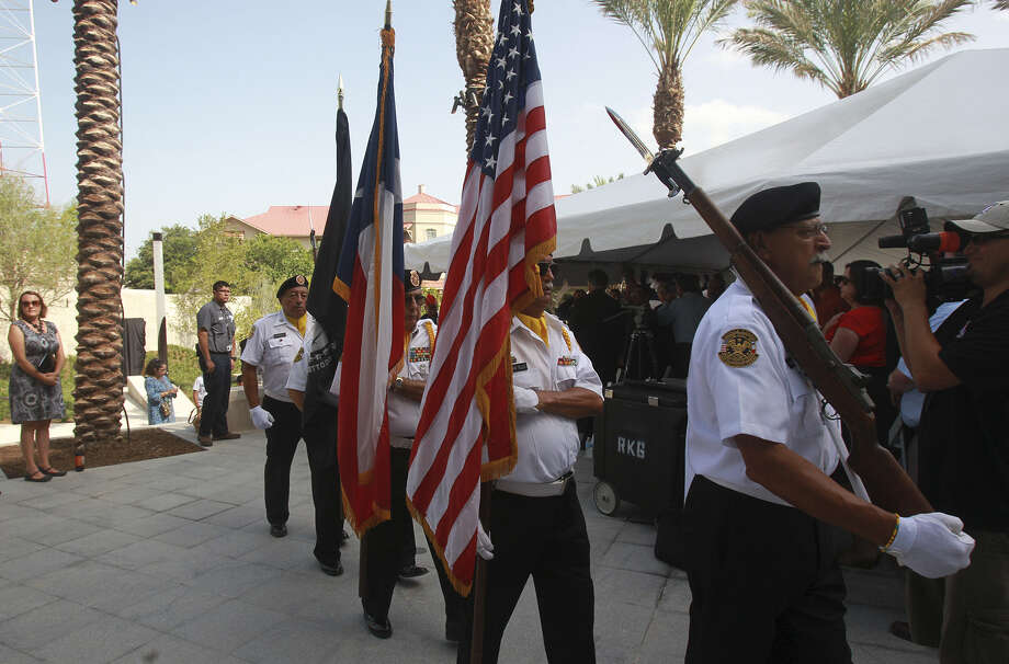 Members of the color guard from the Veterans of Foreign War Post 76 march at the Medal of Honor River Portal during the memorial's grand opening. Photo: John Davenport / San Antonio Express-News / ©San Antonio Express-News/John Davenport