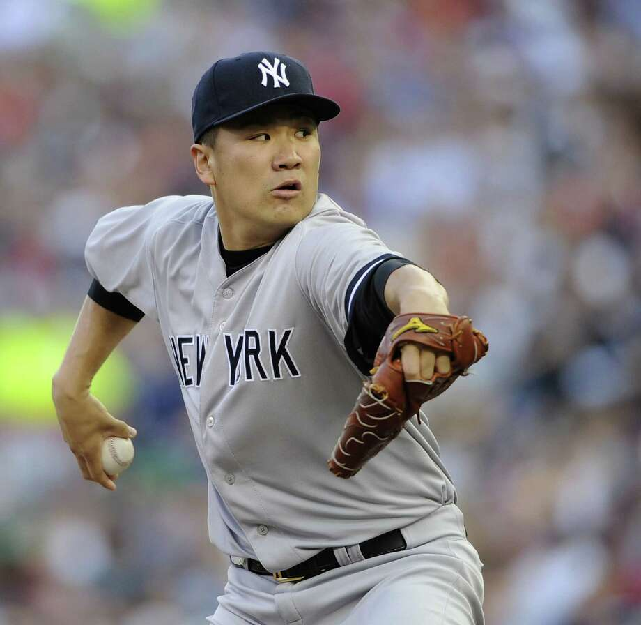 Yankees rookie Masahiro Tanaka, who improved to 12-3 after a 7-4 victory over the Twins on Thursday, is almost certain to be an AL All-Star pick. Photo: Hannah Foslien / Getty Images / 2014 Getty Images