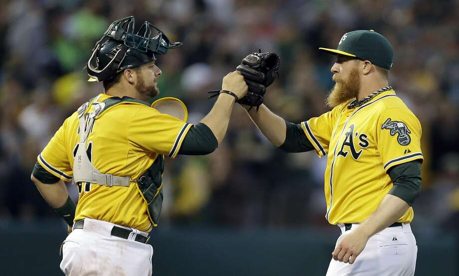 Oakland Athletics' Sean Doolittle, right, celebrates a 4-1 defeat of the Toronto Blue Jays with catcher Stephen Voght at the end of a baseball game on Thursday, July 3, 2014, in Oakland, Calif. (AP Photo/Ben Margot) Photo: Ben Margot, Associated Press