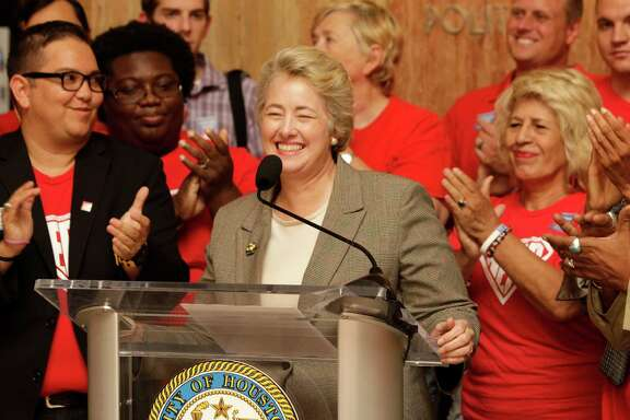 Houston Mayor Annise Parker is applauded by supporters during a media conference about the HERO (Houston Equal Rights) ordinance Thursday, July 3, 2014.