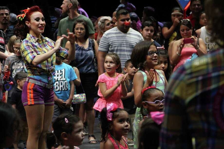 Families enjoy the Ringling Bros. and Barnum and Bailey pre-circus interactions Thursday throughout the AT&T Center. Photo: Jacob Beltran, For MySA.com