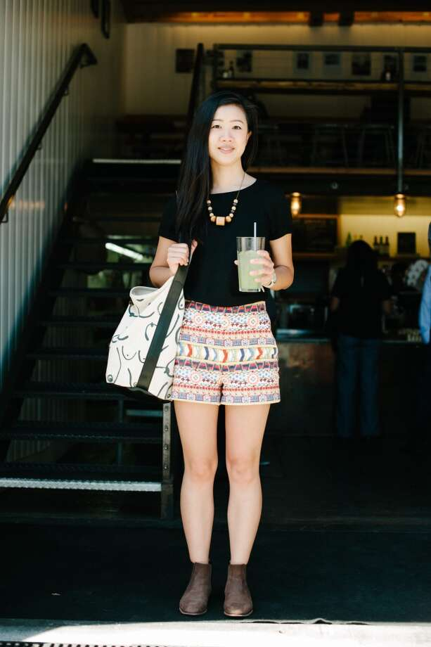 Andrea Cheng enjoys a cucumber citrus mint drink while wearing bright printed shorts in the Mission. Photo: William C Rittenhouse