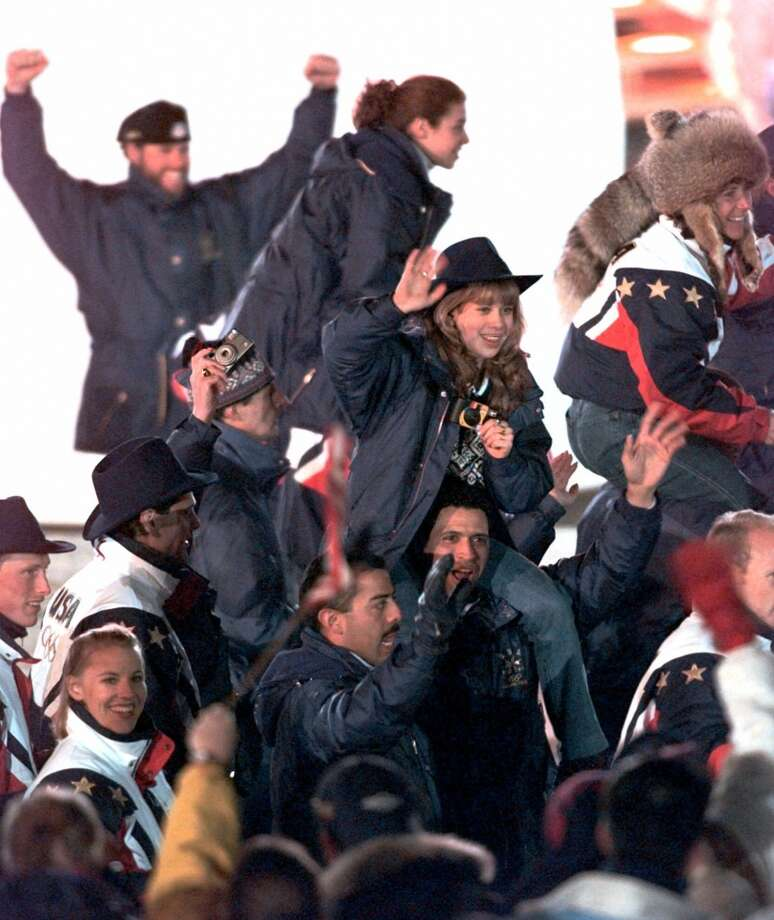 BESTOlympic gold medalist Tara Lipinksi, center, looks adorable at the 1998 Nagano Olympics, but the big winner is the lady in the upper right hand corner to appears to be wearing an entire faux raccoon on her head. Photo: AMY SANCETTA