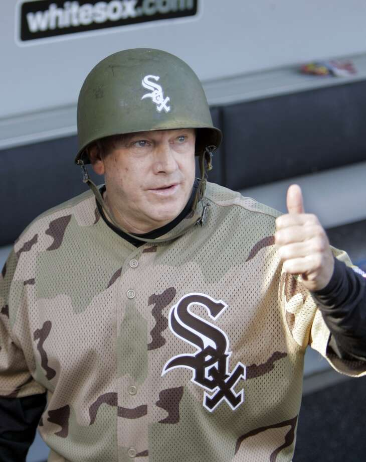 BEST  Most of the camo baseball uniforms look pretty tacky, but then-White Sox third base coach Jeff Cox knows it's all about how you accessorize.  Photo: M. Spencer Green, AP