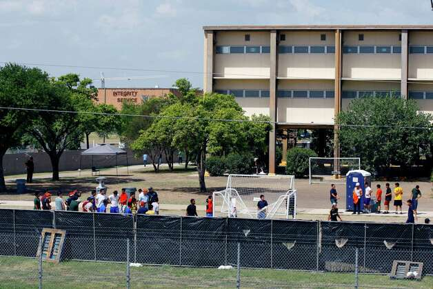 Undocumented minors are seen Wednesday July 2, 2014 in the housing area on Lackland Air Force Base in San Antonio, Texas where they are being kept while they wait for their legal status to be resolved. Photo: William Luther, San Antonio Express-News / © 2014 San Antonio Express-News