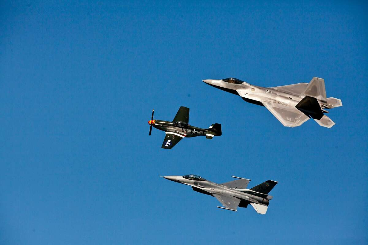 A US Air Force F-22, Raptor, A P-51 Mustang and a F-16 fly in formation as part of the heritage flight during the Fleet Week Air Show Saturday, October 6, 2012.