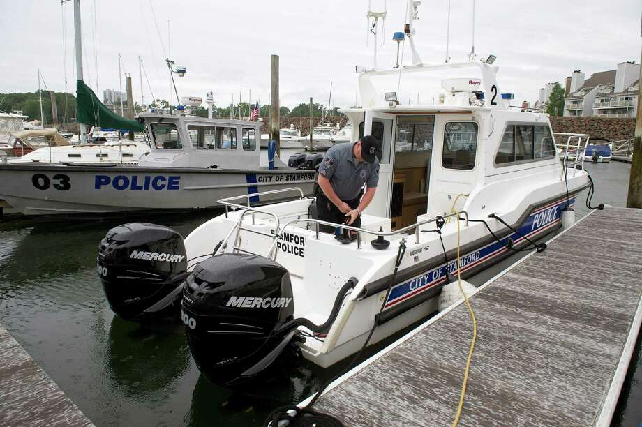 Stamford Police Sgt. Robert Monck works on a police boat at Brewer's Yacht Haven Marina in Stamford, Conn., on Friday, July 4, 2014. Monck and other members of the harbor unit spent part of the day preparing for Saturday's fireworks. Photo: Lindsay Perry / Stamford Advocate