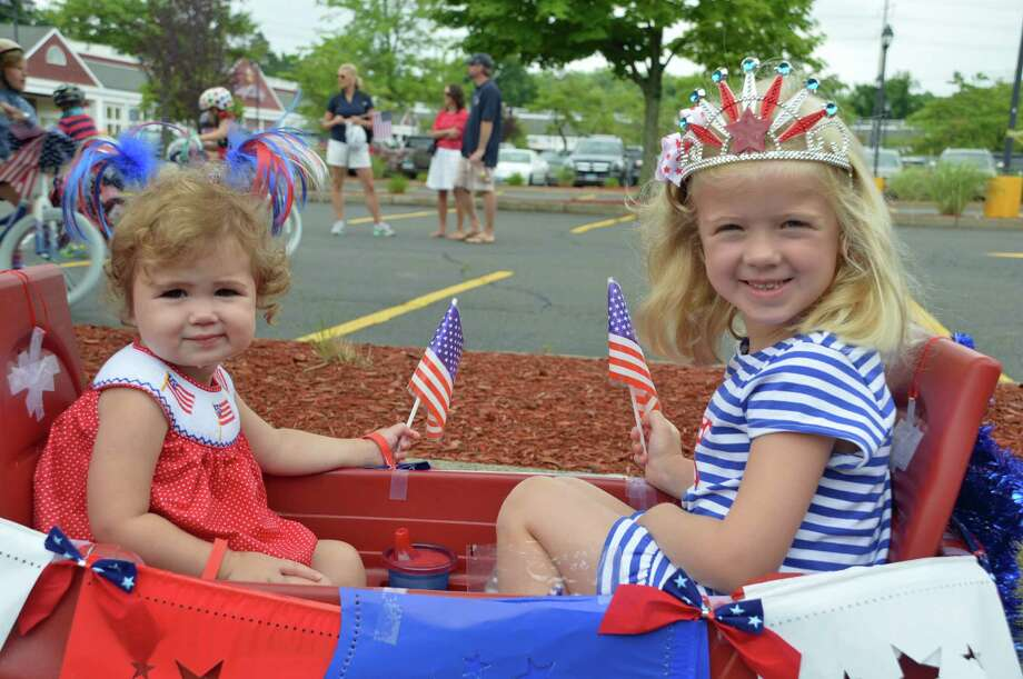 Joan Costa, 2, left, and her sister Cecilia, 5, of Darien, celebrate the Fourth of July at the 10th annual Push-n-Pull Parade at Goodwives Shopping Center Friday, July 4, 2014. Jarret Liotta / For the Darien News Photo: Contributed Photo, Contributed / Darien News Contributed