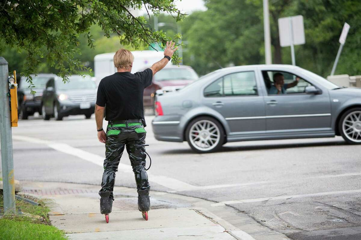 """Montrose area rollerblader Juan Carlos waves to a fan as he skate dances on the corner of Montrose and Allen Parkway during rush hour where he has entertained passersby for the past 15 years Wednesday, June 25, 2014, in Houston. Juan Carlos recently appeared on the television show """"America's Got Talent,"""" where he has made it through the first round of the competition where the winner at the end of the competition wins $1 million. ( Johnny Hanson / Houston Chronicle )"""