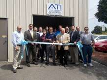 First Selectman George Temple and State Sen. Robert Kane hold the ribbon as it is cut by Autonomy Technology officials marking their move to Oxford July 2.