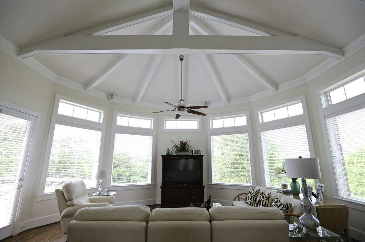 The octagonal family room with 180-degree views echoes Hill Country structures such as the Vereins Kirche in Fredericksburg and gazebo bandstands in Boerne and New Braunfels.