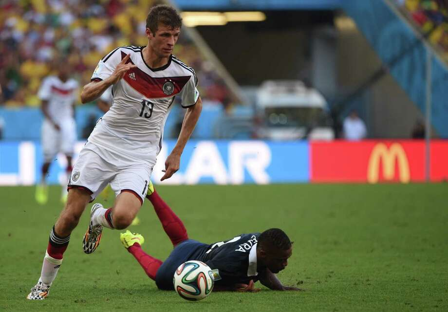 Germany's forward Thomas Mueller (L) controls the ball past France's defender Patrice Evra during the quarter-final football match between France and Germany at The Maracana Stadium in Rio de Janeiro on July 4, 2014,during the 2014 FIFA World Cup. AFP PHOTO / PATRIK STOLLARZPATRIK STOLLARZ/AFP/Getty Images Photo: PATRIK STOLLARZ, AFP/Getty Images / AFP