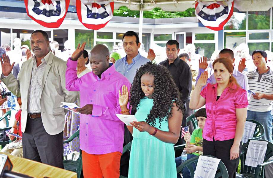 20 immigrants from all over the world become new citizens of the United States during a Citizenship Ceremony at Saratoga National Historical Park Friday July 4, 2014, in Stillwater, NY.  (John Carl D'Annibale / Times Union) Photo: John Carl D'Annibale / 00027632A