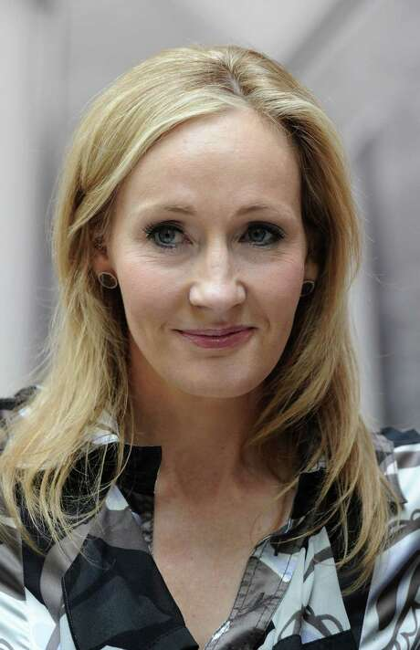 """(FILES) In a file picture taken on June 23, 2011 Harry Potter creator J.K. Rowling poses for photographers during the launch of her new project 'www.pottermore.com' in central London. Rowling said on June 11, 2014 she had donated 1 million GBP (1.2 million euros, 1.7 million USD) to the """"No"""" campaign in the Scottish independence referendum.  AFP PHOTO / CARL COURTCARL COURT/AFP/Getty Images Photo: CARL COURT, Stringer / AFP"""